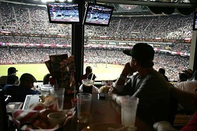 RODNEY HAAS/Miner<br /><br /><!-- 1upcrlf2 -->The view from T.G.I. Friday's Front Row for the Home Run Derby Monday at Chase Field that cost only $10.