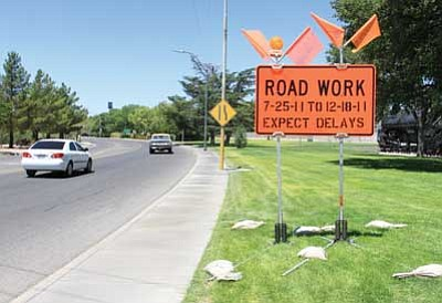 JC AMBERLYN/Miner<br /><br /><!-- 1upcrlf2 -->A sign warns motorists of upcoming construction work near Locomotive Park Thursday. The work that includes Coyote Pass starts at Grandview Avenue in downtown Kingman.