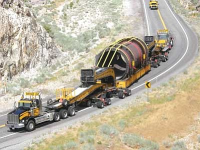 Precision Heavy Haul/Courtesy<br /><br /><!-- 1upcrlf2 -->This 285-ton load will be moving at slightly more than a snail's pace in Kingman early Tuesday morning, serving as a one-vehicle traffic jam as it makes it's way to Miami, a mining town east of Phoenix.