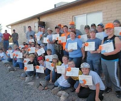 DON MARTIN/For the Miner<br /><br /><!-- 1upcrlf2 -->Graduating class! This is the class photo for graduating class R-2-2011 from the Arizona Hunter Education program. These 34 students ranged in age from 9 to 58 years old and received 32 hours of instruction over a two weekend period from volunteer instructors.