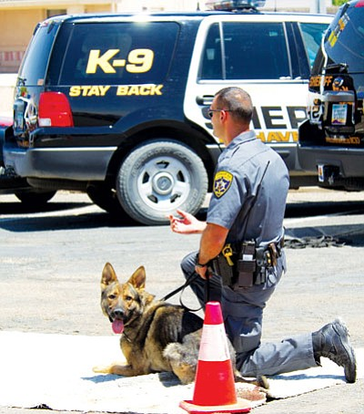 "Courtesy<br /><br /><!-- 1upcrlf2 -->Sgt. Raja Karim with K-9 ""Ganto"" during a community demonstration. The five dogs that work out of the Sheriff's Office often visit with the public to show off their detection skills."