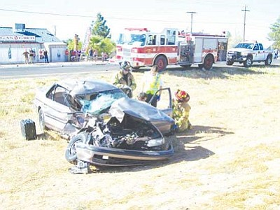Courtesy<br /><br /><!-- 1upcrlf2 -->Rescuers attempt CPR on a driver who was killed in an auto accident on Route 66 Wednesday afternoon.