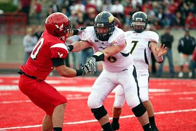 Matt Thompson/NAU Media Relations<br /><br /><!-- 1upcrlf2 -->KHS grad Trey Gilleo blocks an Eastern Washington defender during NAU's game Oct. 9 at Cheney, Wash. The Lumberjacks  lost the game 21-14. Gilleo ended his sophomore year being named Big Sky Conference honorable mention.
