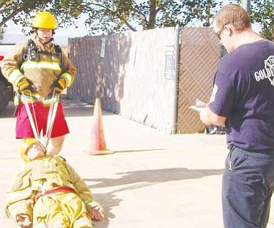 "Courtesy<br /><br /><!-- 1upcrlf2 -->Ted Martin, left, is pictured completing the ""victim drag"" portion of the task performance test under the supervision of Captain Boyd Lewis. Martin has been offered the position of assistant chief with the Golden Valley Fire Department."