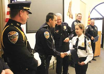 JC AMBERLYN/Miner<br /><br /><!-- 1upcrlf2 -->Gina Cardoza accepts awards Aug. 4. Lined up to congratulate her are, from left to right, officers Dennis Miller, Arron Cowin, Chief of Police Robert DeVries, Randy Sandeen and Eric Urquijo Sr., Lead Advisor to the Explorers program.