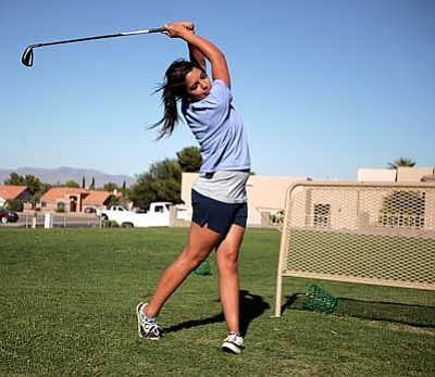 Rodney Haas / Miner<br /><br /><!-- 1upcrlf2 -->KHS's Brianna Peterson practices her tee shot on the driving range of Cerbat Cliffs Golf Course Tuesday. The Lady Bulldogs will open the season with a triangular with Glendale Mountian Ridge, Peoria Centenial and Lake Havasu on Aug. 29.