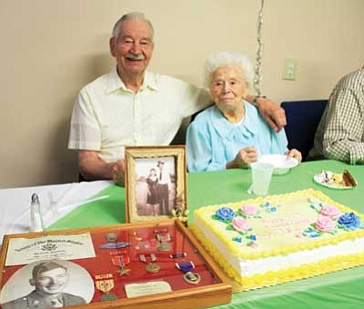 Ray and Lillian Davis celebrated their 70th wedding anniversary Tuesday at a party held by Hilltop Foursquare Church. The couple moved to Kingman from California 24 years ago.<br /><br /><!-- 1upcrlf2 --><br /><br /><!-- 1upcrlf2 -->JC AMBERLYN/Miner
