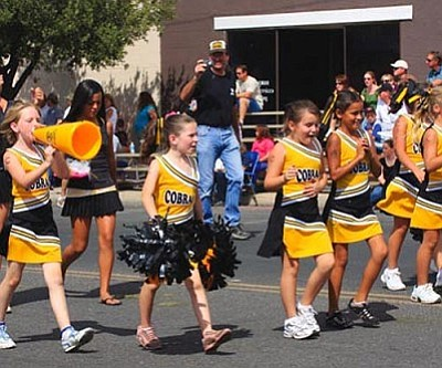 JC AMBERLYN/Miner<br /><br /><!-- 1upcrlf2 -->Cheerleaders participate in a past Andy Devine Days Parade.