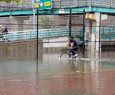 DAVID S./WIkimedia Commons<br /><br /><!-- 1upcrlf2 -->A man bicycling through flood water in East River Park in Manhattan's East Village after Hurricane Irene.<br /><br /><!-- 1upcrlf2 --><br /><br /><!-- 1upcrlf2 -->
