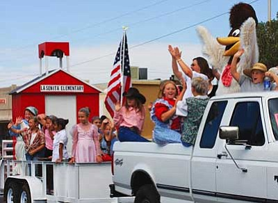 JC AMBERLYN/Miner<br /><br /><!-- 1upcrlf2 -->Students with La Senita Elementary School wave to the crowd at the Andy Devine Days parade.