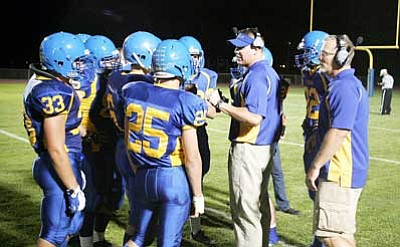 RODNEY HAAS/Miner<br /><br /><!-- 1upcrlf2 -->Kingman High coach Rob York talks strategy with the Bulldogs during a timeout in last week's game against Parker.