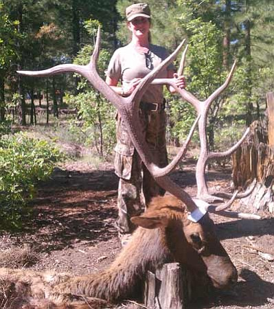 Courtesy<br /><br /><!-- 1upcrlf2 -->Golden Valley resident Leetha Schlosser poses with a mature bull that she shot down.