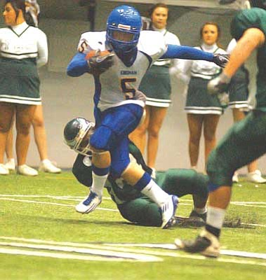RODNEY HAAS / Miner <br /><br /><!-- 1upcrlf2 -->KHS's Matthew Farney tries to evade a Flagstaff defender during the second half of the Bulldogs 48-21 win Oct. 30 in the Walkup Skydome. Farney ended the night with three touchdowns and rushed for 155 yards on 24 carries.  KHS will host Surprise Willow Canyon 7 p.m. tonight.