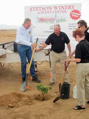 RAND TERWILLEGER/Miner<br /><br /><!-- 1upcrlf2 -->County Supervisor Gary Watson (left) helps Don Stetson and his wife shovel dirt over the first of many grapevines that will be planted at the new Stetson Winery in Valle Vista. <br /><br /><!-- 1upcrlf2 -->