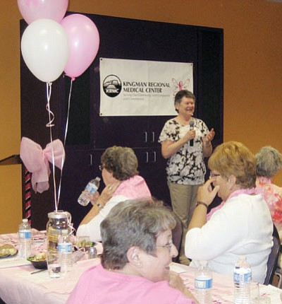 SUZANNE ADAMS/Miner<br /><br /><!-- 1upcrlf2 -->Kathy Younghusband, an 11-year breast cancer survivor, gets a chuckle out of fellow survivors at Thursday's 2nd annual Breast Cancer Survivor luncheon at KRMC.