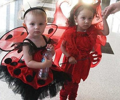 JC AMBERLYN/Miner<br /><br /><!-- 1upcrlf2 -->Ladybug Alana Garibaldi, 18 months, and Lil' Devil Hazelle Gallegos, 2, participate in a costume parade in Kingman last year.<br /><br /><!-- 1upcrlf2 --><br /><br /><!-- 1upcrlf2 -->