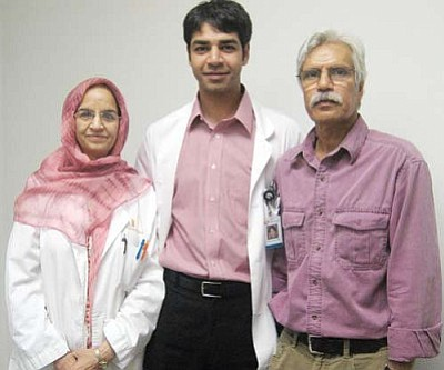 SUZANNE ADAMS/ Miner<br /><br /><!-- 1upcrlf2 -->Dr. Harris Salim, a 1999 graduate from Kingman High School, (center) returned home to work at AIMS with his mother, Dr. Attiya Salim, (left) an anesthesiologist and his father, Shah Salim, (right) the AIMS office administrator.