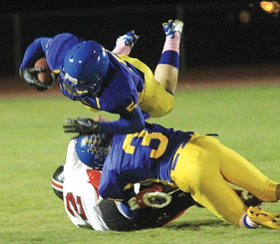 KHS's Matthew Farney flies over Gabe Lumas during the first half of KHS's season-ending 40-13 loss to Prescott Valley Bradshaw Mountain Friday. Farney ended the night with 16 carries for 70 yards and a touchdown. (JC AMBERLYN/Miner)