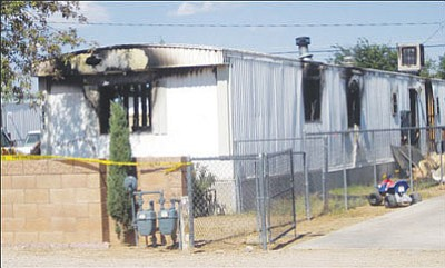SUZANNE ADAMS/Miner<br /><br /><!-- 1upcrlf2 -->The body of 59-year-old John Guerrero was discovered in the remains of this house fire on Packard Avenue in Sept. 2008. Guerrero's son, Shawn, is charged with killing his father and then setting fire to the family's home.