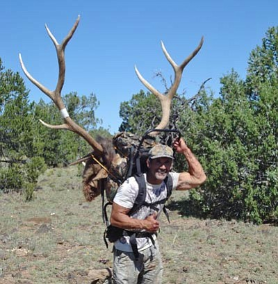 Preparation means success!  Arizona Wildlife Outfitters guide, Gregg Boudoures, packs out a 7 X 6 bull elk that his hunter, Dr. Roy Jones got during a recent Unit 10 early rifle hunt. By preparing for his hunt, Dr. Jones was able to take this trophy with one shot at 37 yards!