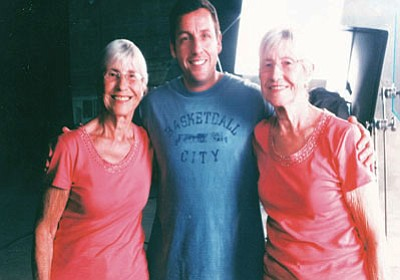 "Courtesy<BR> Patty Olson, left, and her twin sister, Kingman resident Diane Sturm, met ""Saturday Night Live"" alumnus Adam Sandler during filming for his movie about a set of twins."