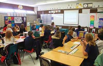 JC AMBERLYN/Miner<BR> La Senita Elementary students in Tanya Wright's fourth- and fifth-grade class input their answers to a question using handheld devices Thursday.