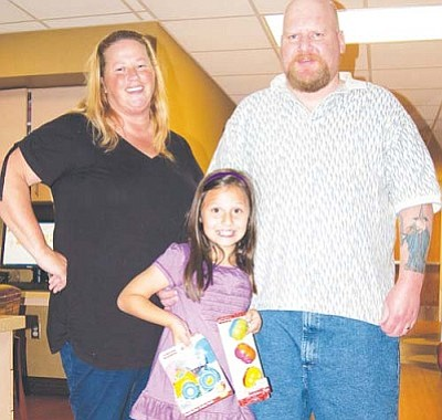 KRMC/Courtesy<br /><br /><!-- 1upcrlf2 -->Kayla Neff, pictured with her parents Tracy and Gerard, visited the Kingman Regional Medical Center Pediatric Ward last month to hand out toys she had received for her 7th birthday.