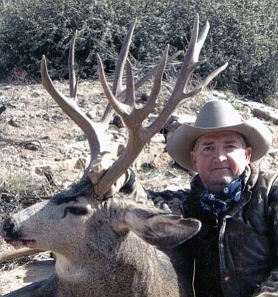 Courtesy<br /><br /><!-- 1upcrlf2 -->George Flournoy poses with a buck he took down with his 243 rifle.