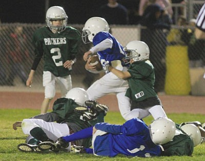 JC AMBERLYN/Miner<br /><br /><!-- 1upcrlf2 -->The Packers' Noah Sowers tackles the Cowboys' Josh Graffius near the end of the game Saturday.