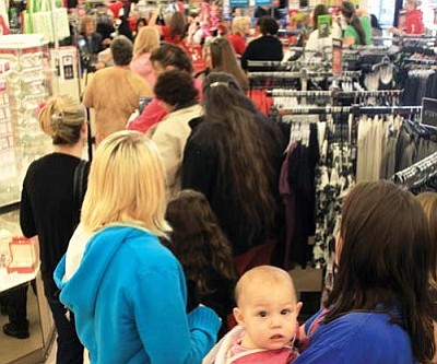 JC AMBERLYN/Miner<br /><br /><!-- 1upcrlf2 -->Crowds of Kingmanites went shopping on Black Friday, the biggest shopping day of the year. Here, Kristy Hobbs (right) stands in line at JC Penney holding her daughter Stephanie. Her other daughter Lorraine stands to the left.<br /><br /><!-- 1upcrlf2 --><br /><br /><!-- 1upcrlf2 -->
