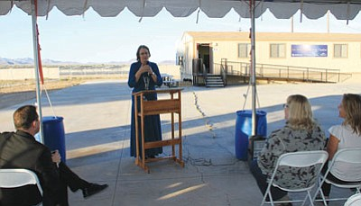 JC AMBERLYN/Miner<br>  Sue Hamilton, principal of La Senita Elementary School, speaks Tuesday during the dedication ceremony for the learning center seen in the background.