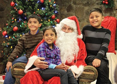 Jacob, Olivia and Dominic Robles visit with Santa Saturday.