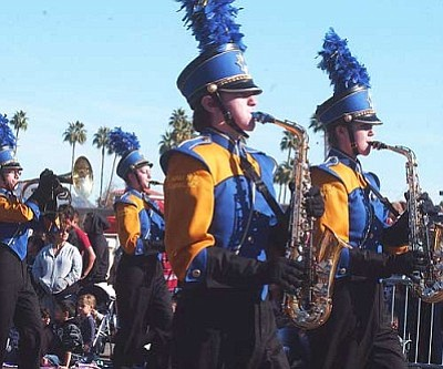 RODNEY HAAS/Miner<br /><br /><!-- 1upcrlf2 -->The KHS Marching Band makes its way down Phoenix's Central Avenue Saturday during the Fiesta Bowl Parade.