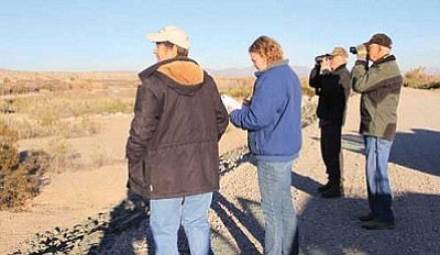 From left to right: DeeDee DeLorenzo, Kristin Hewlett, Rus Hall and Robert Johnson look for birds. Hewlett (who is visiting from Indiana) keeps tracks of birds sighted with a chart. Johnson is from Bullhead City and Hall is visiting from Alberta.