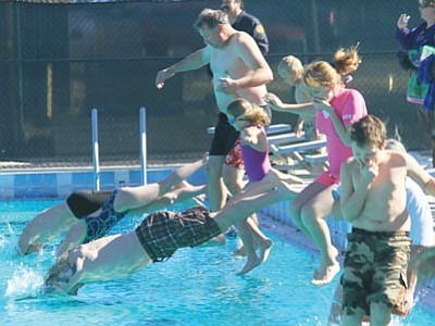 JC AMBERLYN/Miner<br><br> Kingman Parks and Recreation held its 11th Annual Polar Bear Plunge Jan. 1 at Centennial Pool. People of all ages jumped in the pool and then most got out again – quickly! A few stayed in the water to search for sunken rings that garnered them a prize.