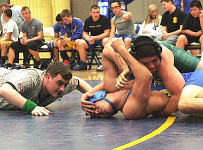 RODNEY HAAS/Miner<br /><br /><!-- 1upcrlf2 -->Flagstaff's Josh Castro tries to pin KHS's Jacob Aviles in the 170-pound match during the Bulldogs' home meet Monday. Castro ended up pinning Aviles in 5:36 as the Bulldogs lost the meet 52-24.