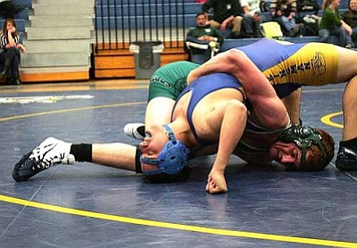 RODNEY HAAS/Miner<br /><br /><!-- 1upcrlf2 -->Flagstaff's Matt Wilson looks to get a grip on Kingman High's Thomas Canez in their 160-pound match Monday. Wilson ended up pinning Canez in 2:33. The Bulldogs placed third at the Joseph City Invitational over the weekend and will look to have the same success this weekend at the Doc Wright Invitational in Winslow.