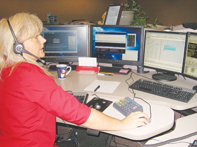 ERIN TAYLOR/Miner<br> Jody Schanaman demonstrates updates to the 911 call center system that allows dispatchers to see the area from which emergency cell phones calls originate.