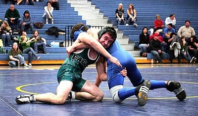 RODNEY HAAS / Miner <br /><br /><!-- 1upcrlf2 -->Kingman High's Matthew Waite looks to take down Flagstaff's Brandon Neely during his 138-pound weight match Jan. 9 at Kingman High. Waite ended up pinning Neely in 4:41 to win the match. Waite qualified for this today's Division II State tournament in Prescott by placing third at the sectional meet this past weekend in Peoria.