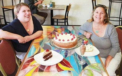 JC AMBERLYN/Miner<br> Carmella Hynes (left) and Denise McMillan of Sirens' Café show off some of their tasty treats – a chocolate raspberry cheesecake, a piece of chocolate strawberry cake, a slice of crème de mint cheesecake and a glass of chocolate mousse.