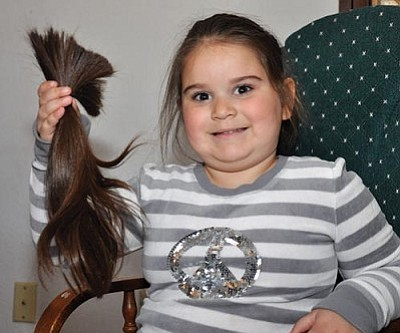 Butch Meriwether/Miner<br /><br /><!-- 1upcrlf2 -->Five-year-old Roxanne Trotter is all smiles after having almost 15 inches of her cut off to donate to Locks of Love.