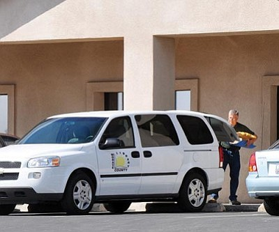 Butch Meriwether/Courtesy<br /><br /><!-- 1upcrlf2 -->An employee of the Mohave County Library unloads books from a van in front of the Library Annex office on Gordon Avenue.<br /><br /><!-- 1upcrlf2 --><br /><br /><!-- 1upcrlf2 -->