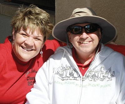 JC AMBERLYN/Miner <br /><br /><!-- 1upcrlf2 -->John and Anne Bathauer smile during the John Bathauer charity golf classic Saturday at Cerbat Cliffs Golf Course. The event raised $35,000 for the Bathauer family as John is battling an aggressive form of melanoma cancer.