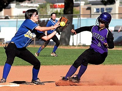 RODNEY HAAS/Miner<br>  KHS second basemen Courtney Baranauskas catches the ball for a force out Saturday morning during the Lady Bulldogs' 7-6 win over Glendale Copper Canyon in bracket play of the Coca-Cola Invitational at Centennial Park. KHS went 1-1 during pool play to secure the No. 2 seed heading into Saturday.