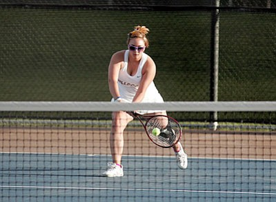 RODNEY HAAS/Miner <br /><br /><!-- 1upcrlf2 -->Kingman High junior, Alexis Diaz returns a volley during her 6-1, 6-4 singles match win over Phoenix Goldwater's Jaden O'Connell Thursday at Kingman High. The Lady Bulldogs won the team score 6-3.