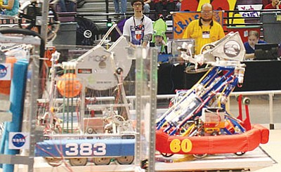 Courtesy<br /><br /><!-- 1upcrlf2 -->Team 60's robot balances on the Coopertition Bridge, the center bridge, with Team 383 from Brazil at the end of a qualification match.