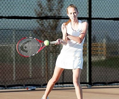 RODNEY HAAS/Miner <br /><br /><!-- 1upcrlf2 -->Kingman High's No. 4 singles player, Gabby Huffer returns a volley during her 6-2, 6-3 win over Flagstaff's Kayla Bayer Monday at KHS. The Lady Bulldogs picked up their fifth stright match win with a 5-4 team win and will travel to the Northwest Tournament in Glendlae this weekend.