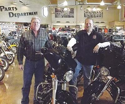 AHRON SHERMAN/Miner<br /><br /><!-- 1upcrlf2 -->Mother Road Harley-Davidson owner John Morotti and General Manager Tony Campbell inside the dealership's showroom Friday.