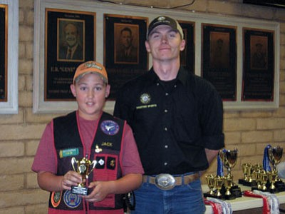 Photo special to the Miner<br /><br /><!-- 1upcrlf2 -->The winner! 11-year-old Jack Cavender won the top honors for the rookie division at the 2012 Commissioner's Cup state trap shoot in Tucson. Cavender set a new record for that division by hitting 92 out of 100 targets. An unidentified G&F official looks on.