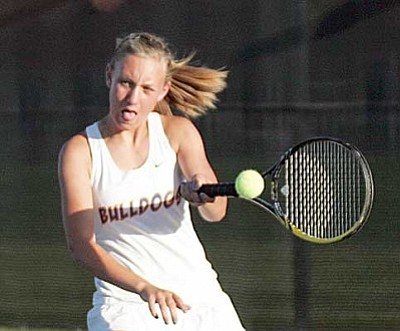 RODNEY HAAS/Miner <br /><br /><!-- 1upcrlf2 -->KHS's Cortney McCans returns a volley from Prescott's Jessica Cross in her 6-3, 6-0 singles win Wednesday. The Lady Bulldogs won the match 6-3 for their eighth match in a row, and qualified for the Division I State Team Tournament beginning May 1.